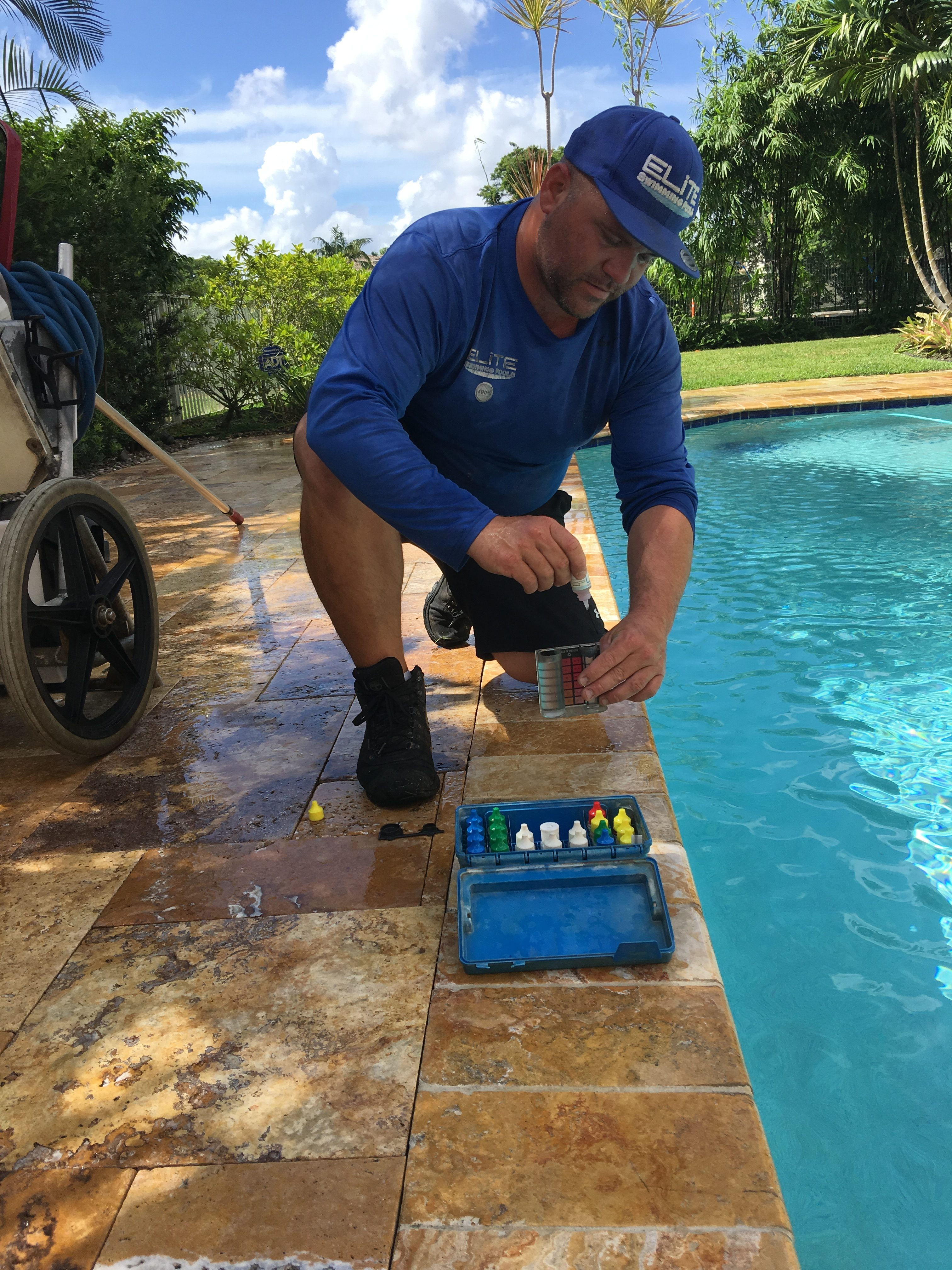 Testing a pool for pool cleaning services in South Florida